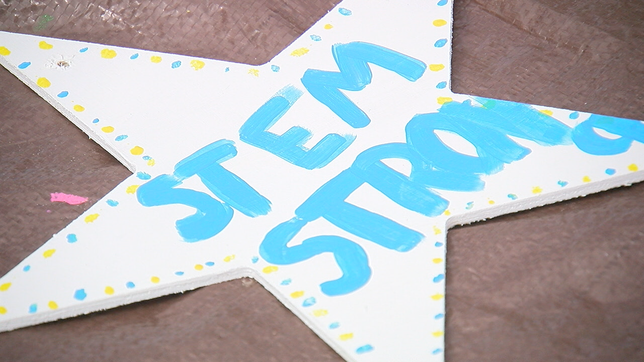 Volunteers paint stars to bring hope to STEM students after tragedy